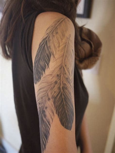 feather tattoo on girl s arm 101 catchy half sleeve tattoos for girls and boys