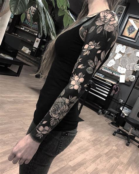 floral sleeve with black background best tattoo design ideas