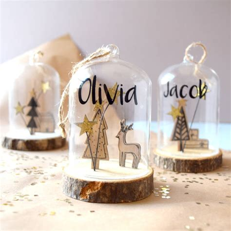 personalised wooden snow globe bauble by the alphabet gift