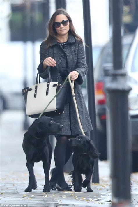 Posh Steps Out In A Sack by Pippa Middleton Co Ordinates Coat With Aspinal Handbag As