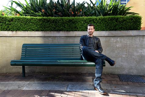person sitting on a bench mulubinba recounts oz armitage fan meet finds the bench