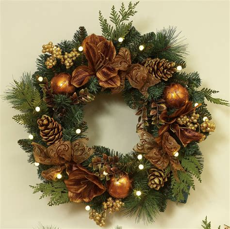green christmas wreath with brown flowers and golden