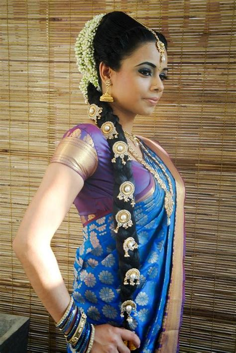 braided hairstyles in sri lanka traditional indian bride wearing bridal saree and