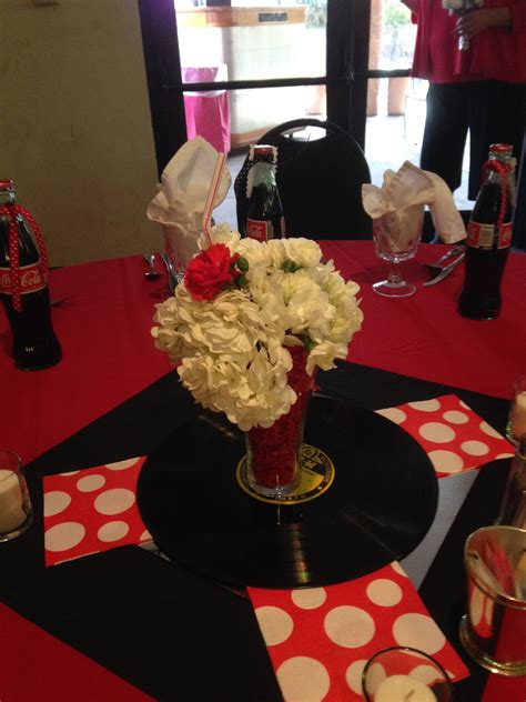 delicious strawberry shake centerpieces for a 50 s themed wedding hosted in our rosario s room