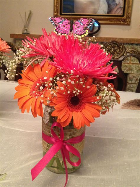 Gerber daisies and spider mums in a mason jar.   DIY mason