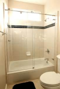 Sliding door over tub shower letting the light in from the shower