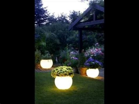 rust oleum glow in the painted pots glow in the flower pot home projects for