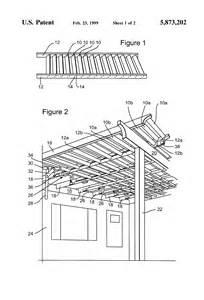patent us5873202 slidably adjustable rigid awning