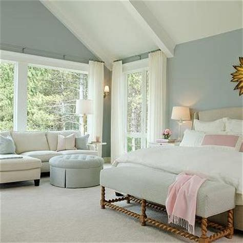 light pink and gold bedroom pale blue bedroom walls with white beaded mirror over sawhorse bench transitional