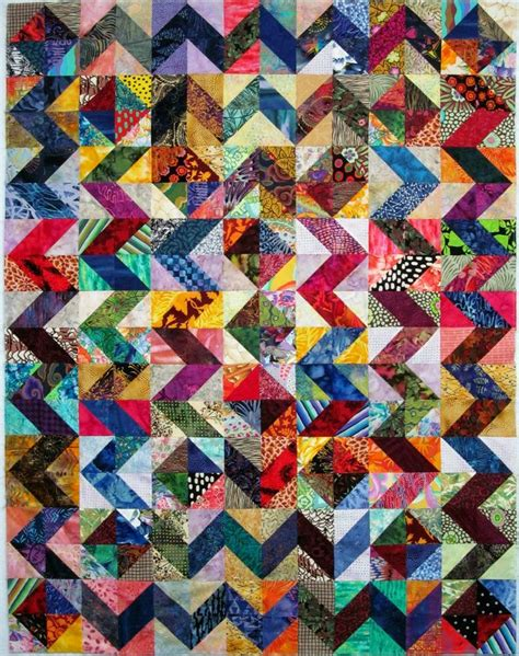 exuberant color gorgeous scrappy half square triangles quilt top on the