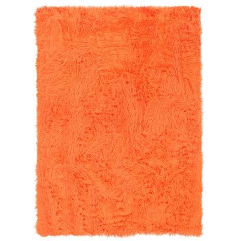 orange fluffy rug this fluffy orange rug