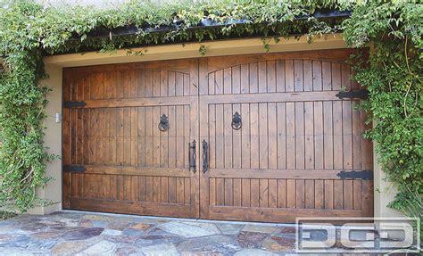 Solid Wood Garage Doors Tuscan Garage Door 04 A Designer Door In Solid Wood Decorative Iron Hardware Traditional