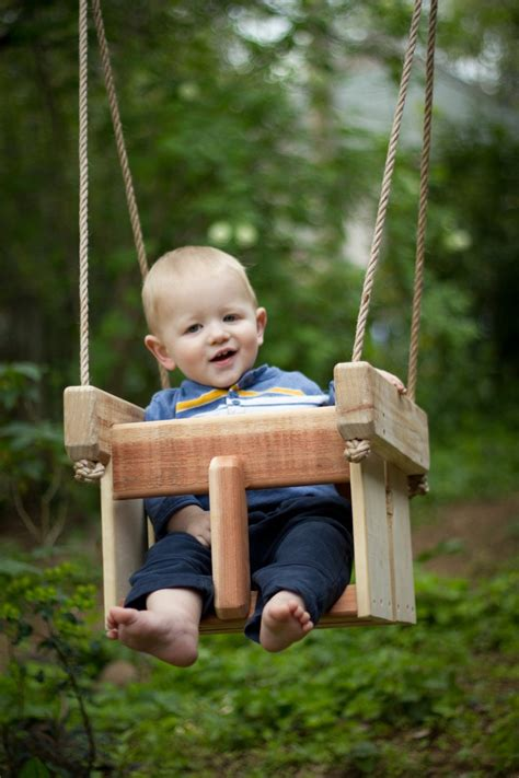 baby on swing garden landscaping playful kids tree swings for backyard