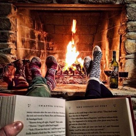 sock fireplace reading in front of a place with fuzzy socks