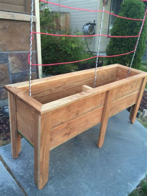 planter box made out of 5 stained fence pickets using a