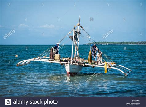small boat outriggers drying clothes on traditional filipino fishing boat with