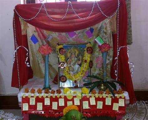 saraswati puja pooja room  rangoli designs