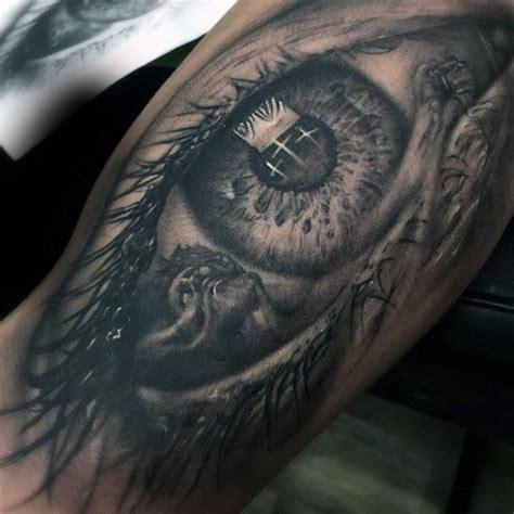 cross tattoo right eye 100 religious tattoos for men sacred design ideas