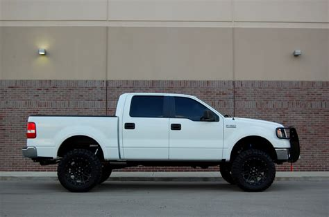 white truck black rims anyone pictures of white trucks and black rims