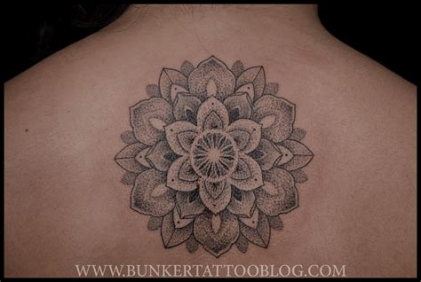 mandala tattoo on back flower