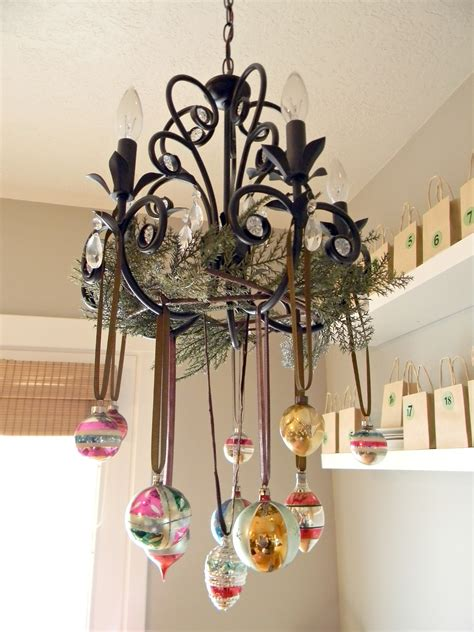 Natural Outdoorsy Woodsy Christmas Decor Organize And Ornaments Hanging From Chandeliers
