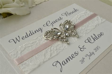 wedding guest book pictures diamante butterfly wedding guest book luxury pearlescent