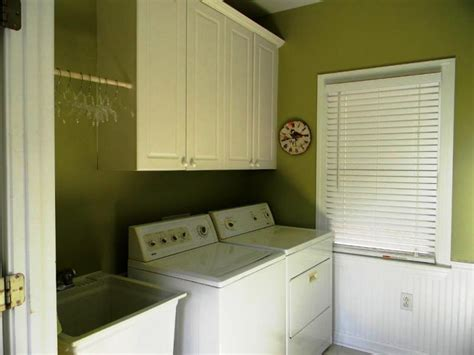 White Wall Cabinet Laundry Room Laundry Room Wall Cabinets Traditional Laundry Room With Driftwood Porcelain Floor Tile