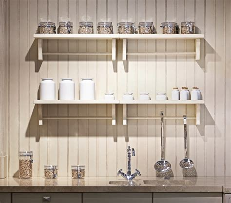 Wooden Kitchen Shelf Unit by White Wooden Wall Mounted Shelves With Hook On White Wall