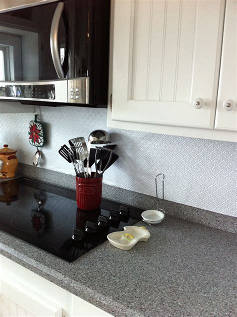 faux tin tiles for kitchen backsplash make a splash with a fleur de lis backsplash decorative
