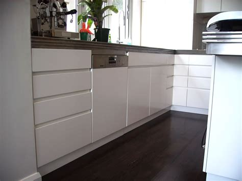 Kitchen Cabinets No Handles Kitchen Cabinet Handles All American Painting Wood Kitchen White Kitchen Bench Stock Image