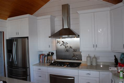 kitchen with stainless steel backsplash glass mosaic