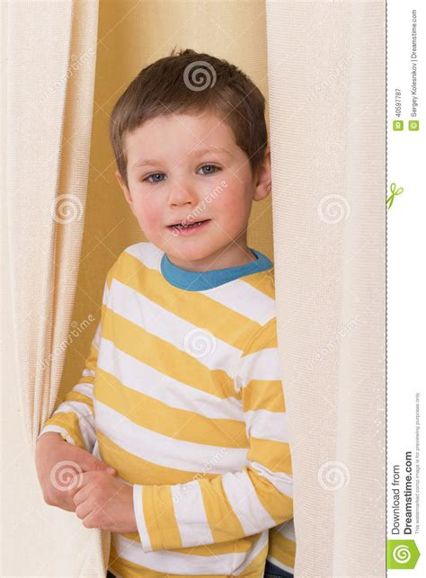 little boy curtains toddler peeking out from behind curtains stock photography