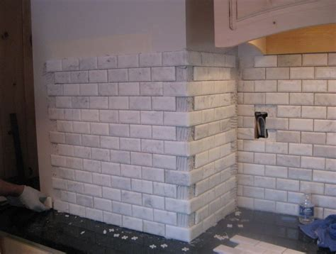 how to install glass tiles on kitchen backsplash tiling a corner backsplash