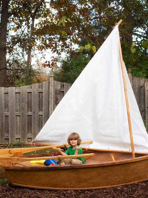build a sandpit in your backyard how to make a rowboat sandbox hgtv