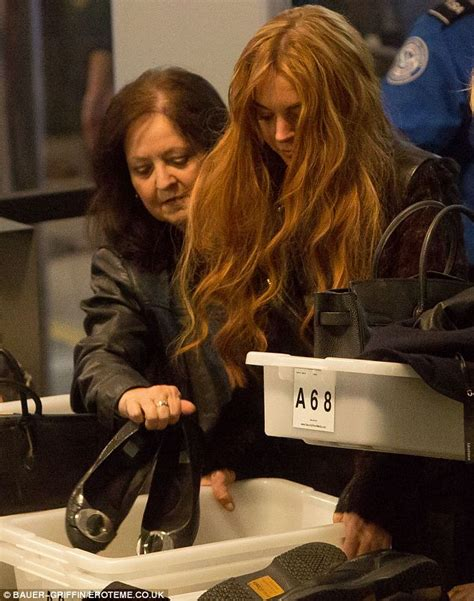 The Look For Less Lindsay Lohan by Lindsay Lohan Looks Less Than Impressed As Bags Get