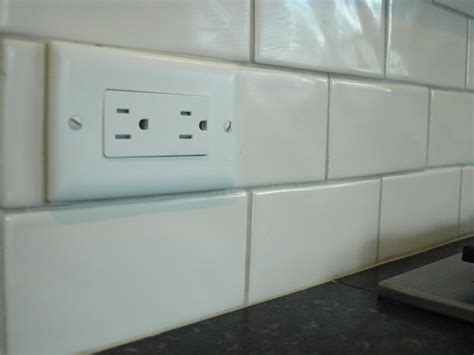 tile backsplash around outlets flipping the outlets helps them disappear in the subway