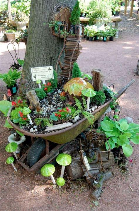 Wheelbarrow Garden Ideas Best 25 Wheelbarrow Garden Ideas On Wheelbarrow Planter Wheelbarrow And Flower