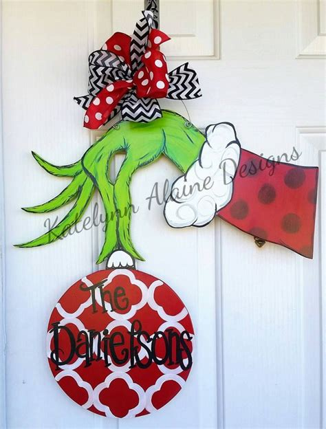 hand tree door decoration grinch holding ornament by katelynnalainedesign