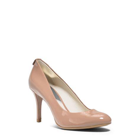 michael kors light pink shoes lyst michael kors flex patent leather mid heel pump in pink