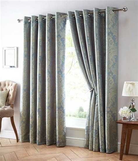 black and gold eyelet curtains eyelet style lined curtains blue gold gold black