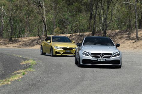 bmw m4 competition v mercedes amg c63 s coupe road