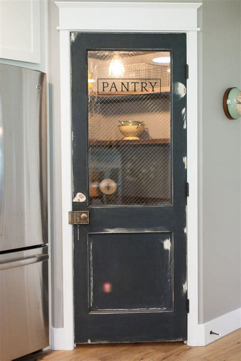 vintage door repurposed as pantry door by rafterhouse