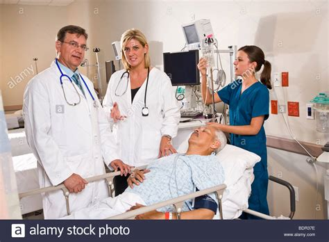 recovery room nursing care doctors and in hospital recovery room with patient stock photo royalty free image