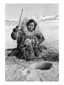 Fishing Wall Murals eskimo woman fishing through ice in alaska photograph