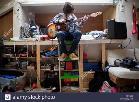 guitar bedroom a teenager plays bass guitar in his bedroom stock photo