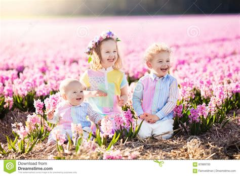 the flower childs play 184643016x kids playing in flower field stock photo image 87889700