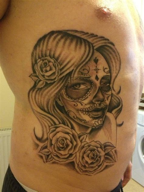 candy skull tattoo grey flowers and sugar skull on side rib