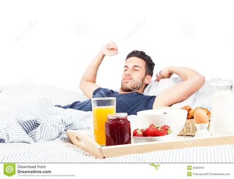 men in bed with other men man is having breakfast in the bed royalty free stock photography image 25923137