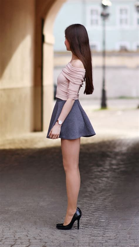 pink top gray mini skirt and black high heels fashion