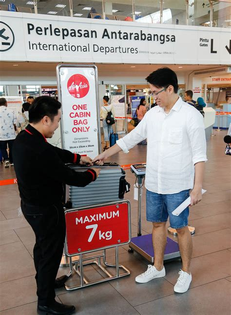 airasia overweight charge airasia reinforces carry on bag rules economy traveller